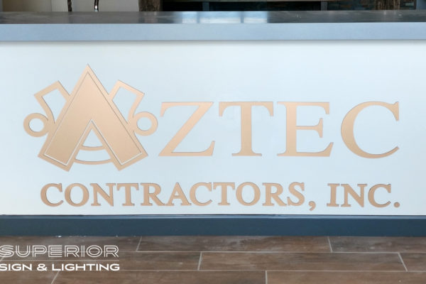 Aztec Contractors - Non illuminated flat cut out letters. Bronze metallic finish.