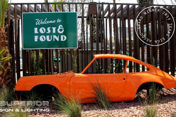 Lost & Found - Car and non illuminated sign.